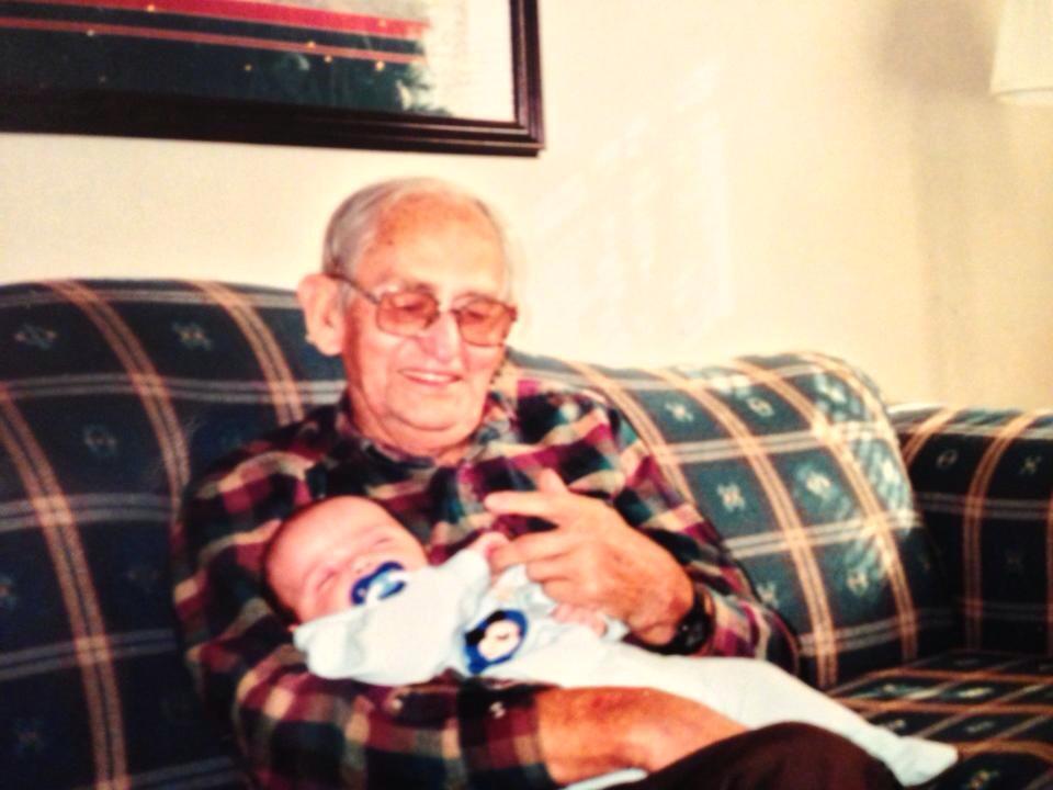 Eugene Lee holding RJ Imel