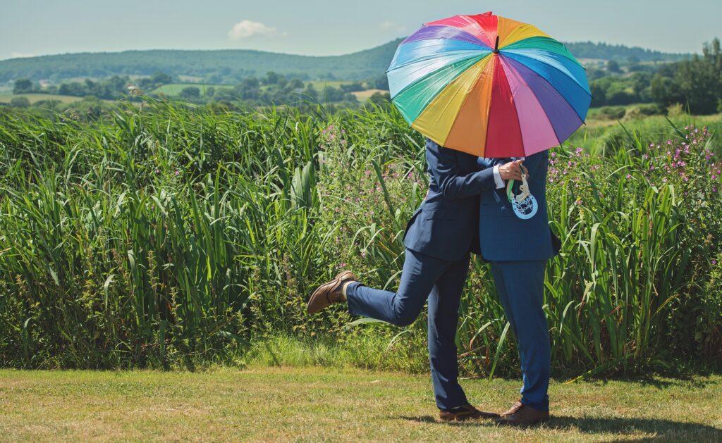 Gay couple in field